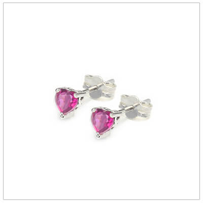 October heart shaped birthstone earrings in sterling silver for children and teens. These birthstone earrings have a decorative basket setting with three prongs.