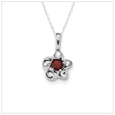 Sterling silver January birthstone necklace set with genuine garnet.