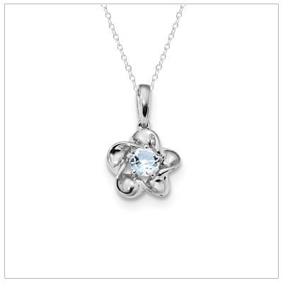 Sterling silver March birthstone necklace with a floral shape and genuine aquamarine gemstone.