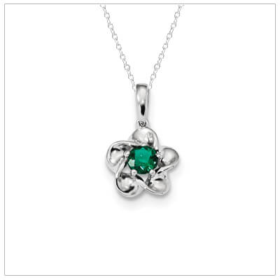 Sterling silver May birthstone necklace for girls with a floral shape.