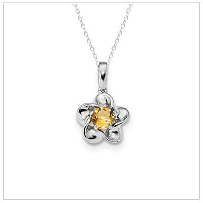 Sterling silver November birthstone necklace with a flower  shape and genuine citrine.