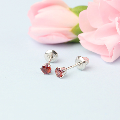 14kt white gold birthstone earrings for January with screw backs.
