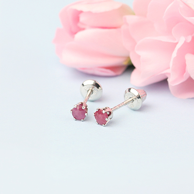 14kt white gold birthstone earrings for July with screw backs.