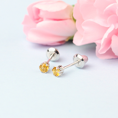14kt white gold birthstone earrings for November with screw backs.