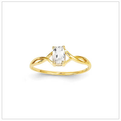 14kt gold birthstone ring for April with a genuine faceted oval white topaz.