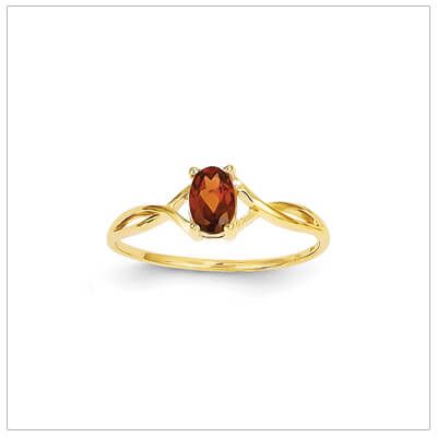 14kt gold birthstone ring for January with a genuine faceted oval garnet.