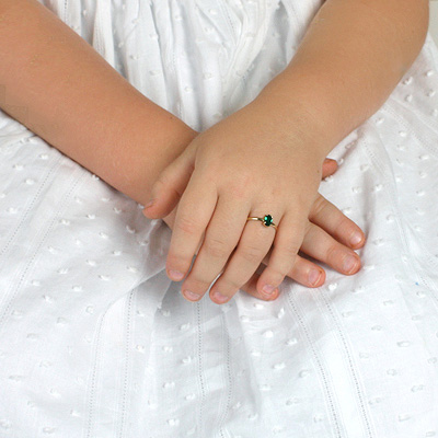 10kt gold birthstone ring for young girls with an oval birthstone and smooth polished gold band.