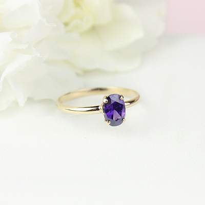10kt gold February birthstone ring for girls with an oval synthetic garnet. Beautiful birthstone ring for young girls with a smooth polished band.