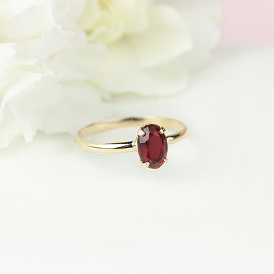 10kt gold January birthstone ring for girls with an oval synthetic garnet. Beautiful birthstone ring for young girls with a smooth polished band.