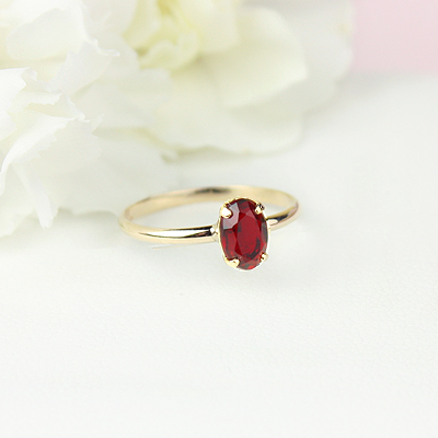 10kt gold July birthstone ring for girls with an oval synthetic garnet. Beautiful birthstone ring for young girls with a smooth polished band.