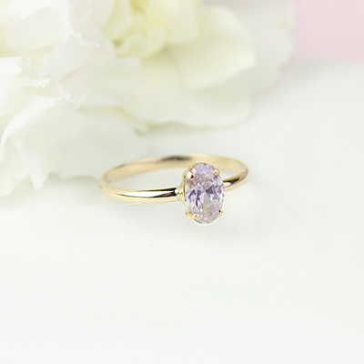 10kt gold June birthstone ring for girls with an oval synthetic garnet. Beautiful birthstone ring for young girls with a smooth polished band.
