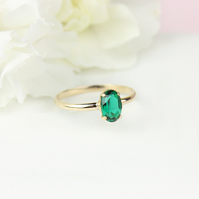 10kt gold May birthstone ring for girls with an oval synthetic garnet. Beautiful birthstone ring for young girls with a smooth polished band.