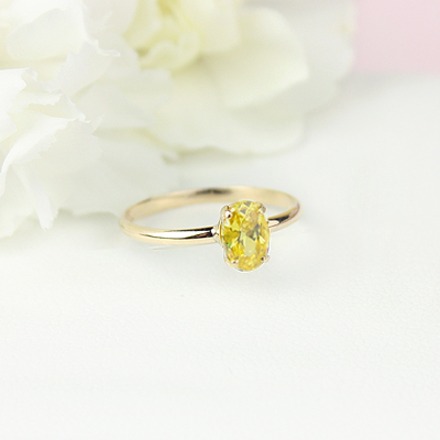 10kt gold November birthstone ring for girls with an oval synthetic garnet. Beautiful birthstone ring for young girls with a smooth polished band.