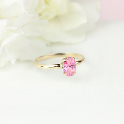 10kt gold October birthstone ring for girls with an oval synthetic garnet. Beautiful birthstone ring for young girls with a smooth polished band.