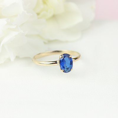 10kt gold September birthstone ring for girls with an oval synthetic garnet. Beautiful birthstone ring for young girls with a smooth polished band.