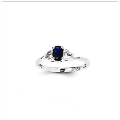 September birthstone ring for girls with a created sapphire birthstone and two side hearts. The birthstone ring is sterling silver, available in 3 sizes.