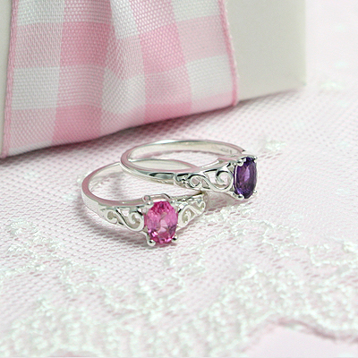 Birthstone rings for girls in sterling silver with a swirl-patterned band. A quality made birthstone ring.