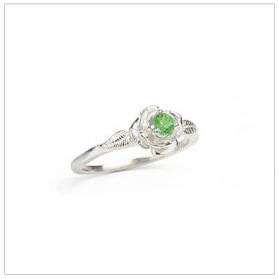 Sterling silver rose-shaped ring set with genuine peridot, a silver birthstone ring for August.
