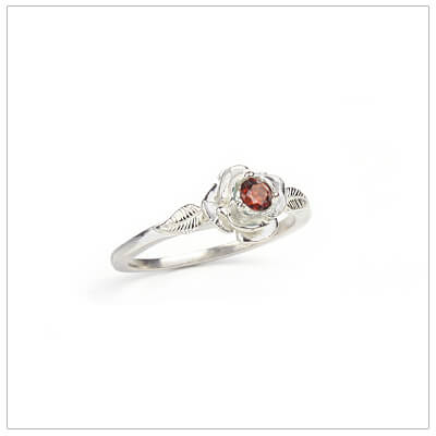 Sterling silver rose-shaped ring set with genuine garnet, a silver birthstone ring for January.