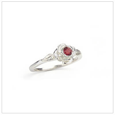 Sterling silver rose-shaped ring set with genuine ruby, a silver birthstone ring for July.