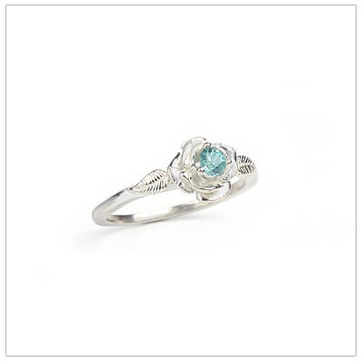 Sterling silver rose-shaped ring set with genuine aquamarine, a silver birthstone ring for March.