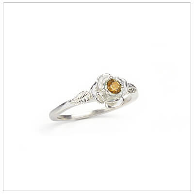 Sterling silver rose-shaped ring set with genuine citrine, a silver birthstone ring for November.