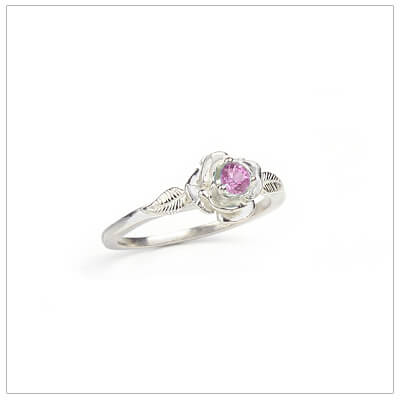 Sterling silver rose-shaped ring set with genuine pink topaz, a silver birthstone ring for October.