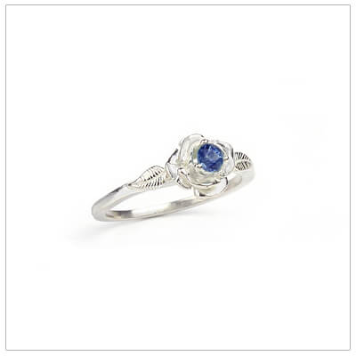 Sterling silver rose-shaped ring set with genuine sapphire, a silver birthstone ring for September.