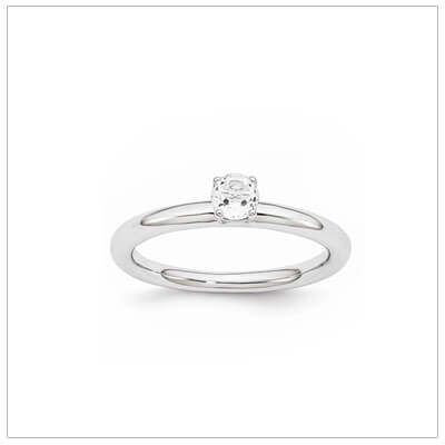 Classic styled solitaire birthstone ring for April in sterling silver. Sizes available for children, teens, and adults.