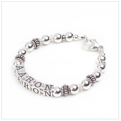 All sterling silver boys bracelet with a touch of oxidized silver; simple and classy styling for boys.