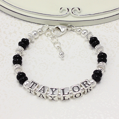 Handsome bracelets for boys in bright sterling silver and abacus shaped black onyx.