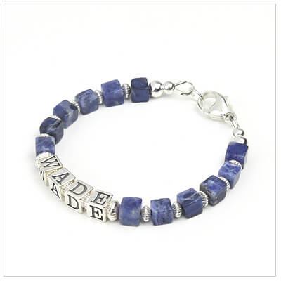 Boys bracelet personalized with name in sterling silver and blue or brown gemstones.