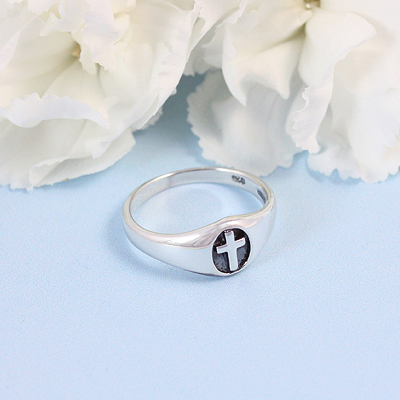Handsome sterling Cross ring for boys with an oxidized background. The Cross ring comes in 3 sizes.