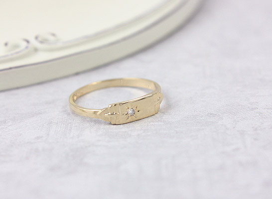 Boys signet ring in 14kt yellow gold set with a genuine diamond.