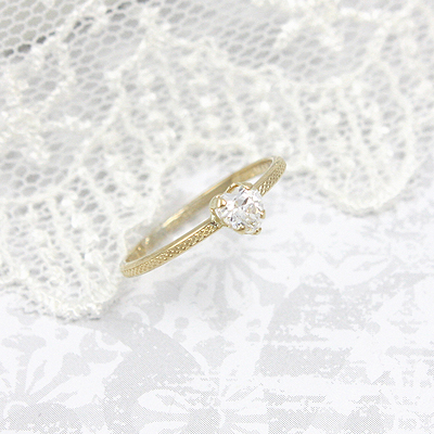 April heart shaped birthstone ring with 10kt gold patterned band.
