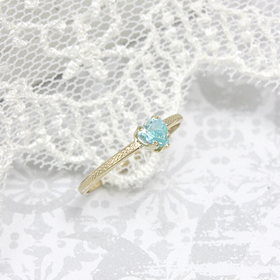 March heart shaped birthstone ring with 10kt gold patterned band.
