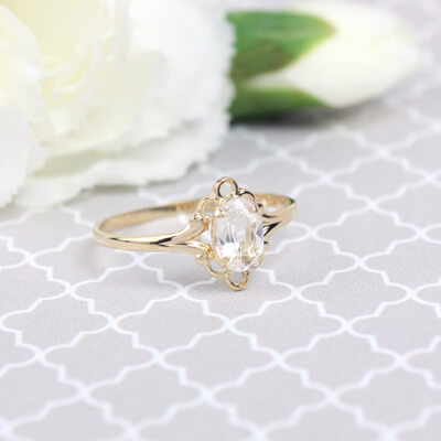 Girls 14kt gold April birthstone ring with an oval genuine birthstone.