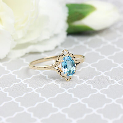 Girls 14kt gold December birthstone ring with an oval genuine birthstone.