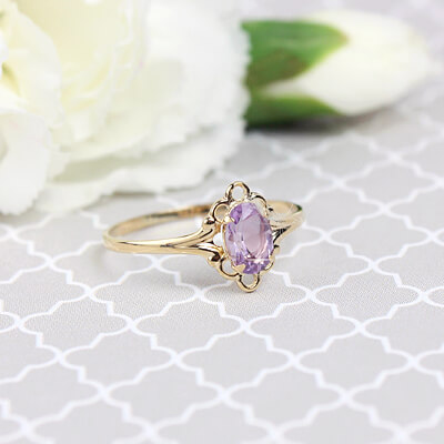 Girls 14kt gold February birthstone ring with an oval genuine birthstone.