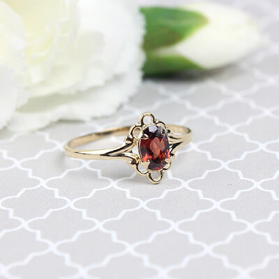 Girls 14kt gold January birthstone ring with an oval genuine birthstone.