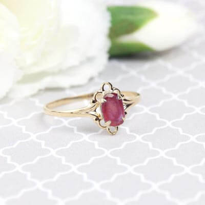 Girls 14kt gold July birthstone ring with an oval genuine birthstone.