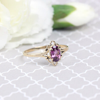 Girls 14kt gold June birthstone ring with an oval genuine birthstone.