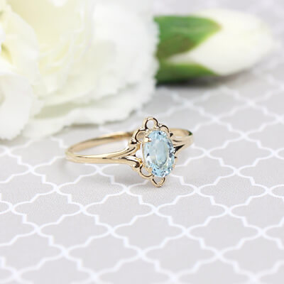 Girls 14kt gold March birthstone ring with an oval genuine birthstone.