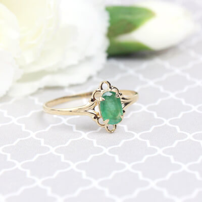 Girls 14kt gold May birthstone ring with an oval genuine birthstone.