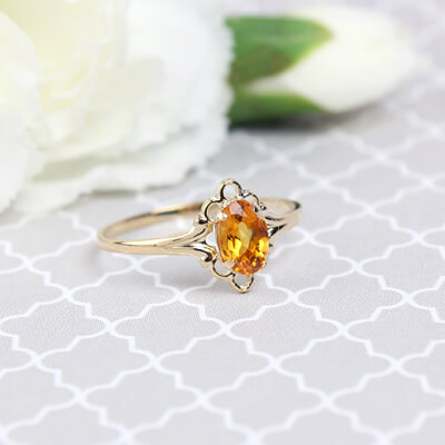 Girls 14kt gold November birthstone ring with an oval genuine birthstone.