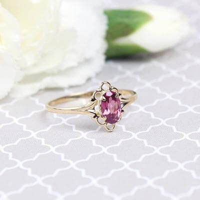 Girls 14kt gold October birthstone ring with an oval genuine birthstone.