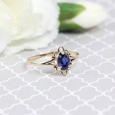 Girls 14kt gold September birthstone ring with an oval genuine birthstone.