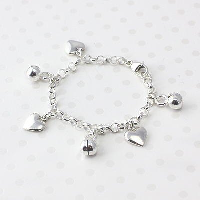 Baby and toddler charm bracelet with hearts and bells charms included.