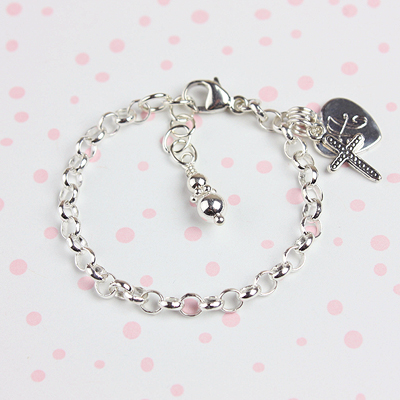 Silver charm bracelet for babies and toddlers with engraved heart and Cross charms included.