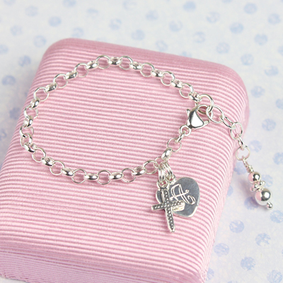 Sterling silver charm bracelet for baby and toddler with included charms.